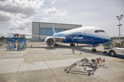 The first Boeing 787 Dreamliner moves from the paint hangar out to the fuel dock at the Boeing facility in Everett, Wash. (Photo/Boeing)