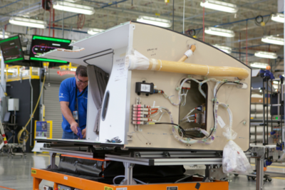 Boeing employees in North Charleston work on components of the 787 Dreamliner during a plant tour in February. (Photo/Kim McManus)